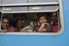 Ella, Sri Lanka, November 13, 2015: Sri Lankan family watching through the train window. In Ella Stock Photo