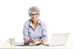 Ellderly woman working with a laptop Stock Image
