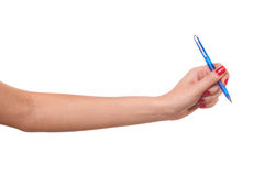 Elle a écrit dans le crayon lecteur. Images libres de droits