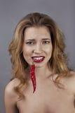 Elle a peur du piment Images libres de droits