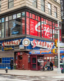 Ellen's Stardust Diner Times Square. NEW YORK CITY - MARCH 14, 2014:  Street view of Manhattan landmark Ellen's Stardust Diner in Times Square Stock Photos