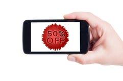50 eller femtio av rabatterat prisbegrepp på smartphonen Royaltyfri Bild
