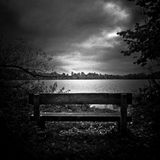 Ellesmere lake and lone park bench, Shropshire, England Stock Image