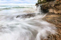 Elliot Falls on Miners Beach at Pictured Rocks. Munising, Michig. Elliot Falls flows into Lake Superior on Miners Beach at Pictured Rocks National Lakeshore Stock Photography