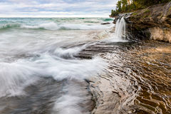 Elliot Falls on Miners Beach at Pictured Rocks. Munising, Michig. Elliot Falls flows into Lake Superior on Miners Beach at Pictured Rocks National Lakeshore Stock Photos