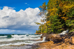 Elliot Falls at Miners Beach. Elliot Falls, a waterfall in Michigan's Pictured Rocks National Lakeshore, cascades into Lake Superior across the rocks of Miner's Royalty Free Stock Photo