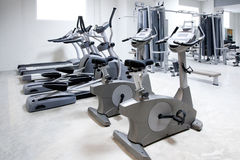 Elliptical cross trainer, bicycle treadmill Stock Photos