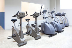 Elliptical cross trainer, bicycle treadmill Royalty Free Stock Photography