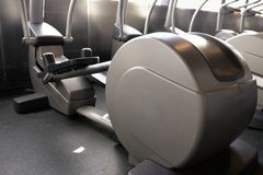 Elliptical cross trainer in modern fitnes sport club Royalty Free Stock Photography