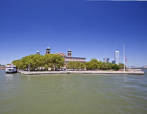 Ellis Island. On the Hudson with Jersey City background Stock Photos