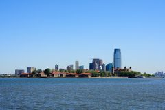 Ellis Island and New Jersey. Ellis Island with New Jersey buildings in the background - New York City, USA Royalty Free Stock Photo