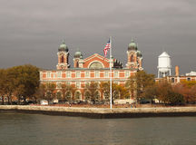 Ellis Island, New York. View of Ellis Island immigration museum in New York with American flag Royalty Free Stock Images