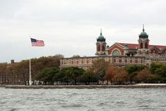 Ellis Island in NYC. American flag, Upper Bay stock photo