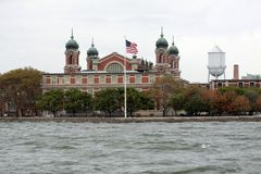 Ellis Island in NYC. American flag, Upper Bay stock images