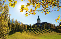Ellmau castle, view through golden maple leaves Royalty Free Stock Images