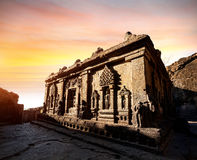 Ellora caves in India. Carved statues in ruined building at sunset in Ellora cave near Aurangabad, Maharashtra, India Royalty Free Stock Images