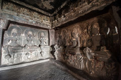 Ellora Caves UNESCO World Heritage Site. Statue of big Buddha, sanctuaries devoted to Buddhism, Hinduism and Jainism. Temples and monasteries near Aurangabad stock images