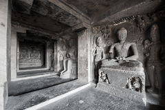 Ellora Caves UNESCO World Heritage Site. Statue of big Buddha, sanctuaries devoted to Buddhism, Hinduism and Jainism. Temples and monasteries near Aurangabad royalty free stock photo