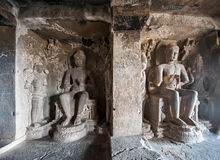 Ellora Caves UNESCO World Heritage Site. Statue of big Buddha, sanctuaries devoted to Buddhism, Hinduism and Jainism. Temples and monasteries near Aurangabad royalty free stock image