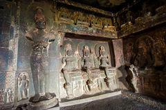 Ellora Caves UNESCO World Heritage Site. Statue of big Buddha, sanctuaries devoted to Buddhism, Hinduism and Jainism. Temples and monasteries near Aurangabad stock photography