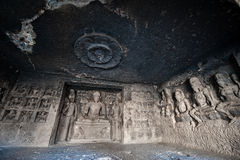 Ellora Caves UNESCO World Heritage Site. Statue of big Buddha, sanctuaries devoted to Buddhism, Hinduism and Jainism. Temples and monasteries near Aurangabad royalty free stock photos