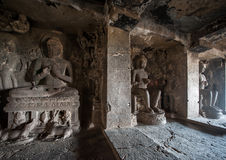 Ellora Caves UNESCO World Heritage Site. Statue of big Buddha, sanctuaries devoted to Buddhism, Hinduism and Jainism. Temples and monasteries near Aurangabad stock photo