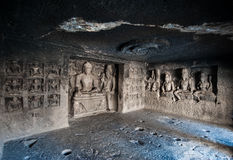 Ellora Caves UNESCO World Heritage Site. Statue of big Buddha, sanctuaries devoted to Buddhism, Hinduism and Jainism. Temples and monasteries near Aurangabad royalty free stock photography