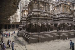 Ellora, India - 15th August 2016: People visiting to the caves i royalty free stock photography