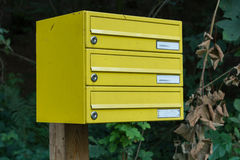 Ellow post box with several compartments. Yellow mailbox with several lockers royalty free stock photography