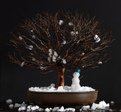 Elm bonsai tree with snowman. In winter on a dark background Royalty Free Stock Photos