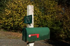 Detail of an old green mailbox at the access to a road in Oregon, USA. royalty free stock photography