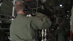 Elmendorf Alaska, November 2015, US Air Force. Crewmember of an aircraft fix a litter in a HC 130 Combat King for a aeromedical evacuation stock footage