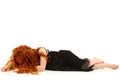Elmentary Child Girl Crying on Floor. Young elemantary girl child laying on floor crying. No face Stock Image