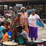 Unidentified Ghanaian women in colored clothes gather near Elmi. ELMINA, GHANA -JAN 18, 2017: Unidentified Ghanaian women in colored clothes gather near Elmina royalty free stock images