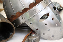 Elmo cavaliere n.2. Closeup view of a medieval helmet and other typical items Royalty Free Stock Photo