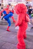 Elmo fights Spiderman Stock Image