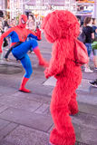 Elmo fights Spiderman Stock Image