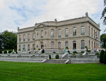 The Elms Newport Mansion. The facade and the fountains with green statues of the Elms Mansion Stock Images