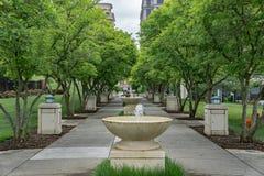 Elmwood Park. Roanoke, VA – May 13th: Fountain row with decorative tree located in Elmwood Park located in Roanoke, VA on May 13th, 2017 stock image