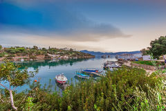 ELOUNDA BAY- CRETE- INTRALEX 2016. ELOUNDA`S BAY WITH FISHING BOATS AT LASITHI AREA. SUNSET AND BLUE SKY AT THE BACKROUND - CRETE ISLAND- GREECE Stock Images