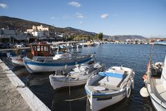 Small boats in a Cretan harbour. Elounda, Crete, Greece. 2017. Fishing boats line the harbour in this scenic Cretan town Stock Photography