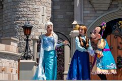 Elsa, Anna and Minnie on  Mickey`s Royal Friendship Faire on Cinderella Castle in Magic Kingdom at Walt Disney World Resort  1. Orlando, Florida. May 17, 2019 stock photo