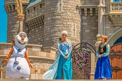 Elsa , Anna and Olaf on Mickey`s Royal Friendship Faire on Cinderella Castle in Magic Kingdom at Walt Disney World Resort  8. Orlando, Florida. May 17, 2019 stock photo