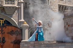 Elsa singing on  Mickey`s Royal Friendship Faire on Cinderella Castle in Magic Kingdom at Walt Disney World Resort  3. Orlando, Florida. May 17, 2019. Elsa royalty free stock photography