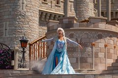 Elsa singing on  Mickey`s Royal Friendship Faire on Cinderella Castle in Magic Kingdom at Walt Disney World Resort  2. Orlando, Florida. May 17, 2019. Elsa royalty free stock photography