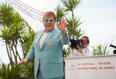 Elton John assiste al photocall per fotografie stock