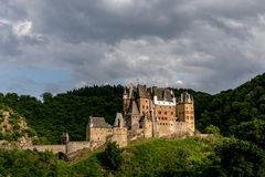 Eltz Castle, a medieval castle located on a hill in the forest. Germany stock image