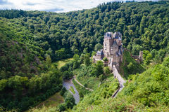 Eltz Castle. A medieval castle located on a hill in the forest Stock Image