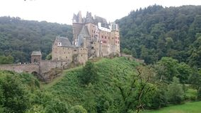 The Eltz Castle. Eltz Castle is a medieval castle nestled in the hills above the Moselle River between Koblenz and Trier, Germany Royalty Free Stock Photo