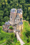 Eltz castle nestled in the hills above the Moselle River Stock Photography
